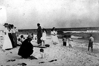A Victorian-era family enjoys an outing at Panama City Beach in the early 1900's